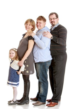 Staged Studio photography turns from left to right. The little blonde girl in a blue dress, happy pregnant mom, the eldest son is old enough and happy family. All are one after the other hardly-Isolated on white background