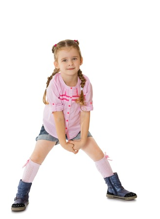 short shorts: Funny little girl wearing a pink sweater and short shorts posing for the camera -Isolated on white background Stock Photo
