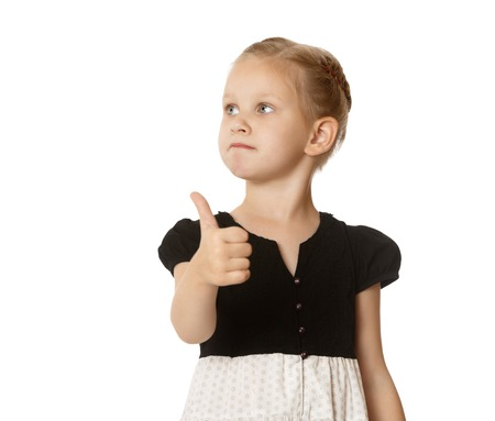 facing away: Closeup of a pretty little blonde girl stretched out a hand with a raised thumb to the top. Girl shows gesture. the little girl looks to the side facing away from the camera-Isolated on white background