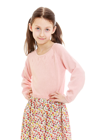 perky: Perky little girl in a long summer dress and a pink sweater posing for the camera. Closeup-Isolated on white background