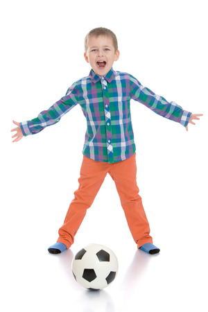 peers: Joyful little boy shouting my mouth wide , he plays with his peers in football-Isolated on white background Stock Photo