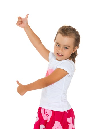 perky: Perky little girl is standing sideways to the camera and indicates with both hands the gesture of OK-Isolated on white background