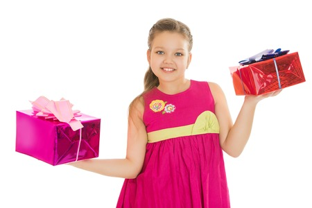 chubby girl: Beautiful chubby girl children holding two gift boxes.Isolated on white background Stock Photo