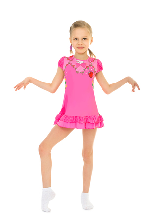 Stylish little girl ballerina in pink short dress shaking his hands-Isolated on white background Stock Photo