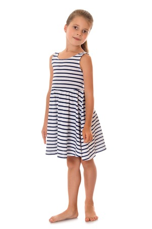 skinny girl: Beautiful skinny girl in school-aged summer striped dress .a girl stands barefoot on the floor - Isolated on white background