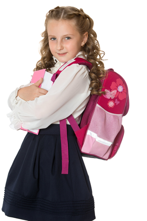 schoolgirl uniform: Beautiful girl schoolgirl in white blouse and black skirt. Behind the girls school bag. Closeup - Isolated on white background