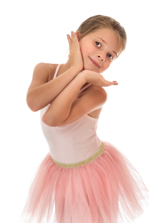 ballerina costume: Charming slender little girl in a pink ballerina costume . Closeup - Isolated on white background