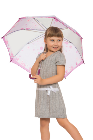 umbrela: Charming , shy, beautiful little girl with flowing blonde hair and a short fringe , took refuge under the umbrella. The girl thoughtfully looks aside. -Isolated on white background