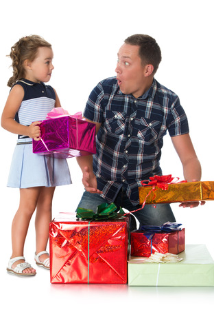 Happy, joyful dad and daughter looking at the gifts that they gave to mom for Christmas - Isolated on white background.The concept of childhood and the holidays