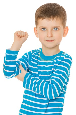 beau mec: Little boy in striped t-shirt bent arm at the elbow, he is showing his bicep . Closeup - Isolated on white background.The concept of a Happy childhood and sport Banque d'images