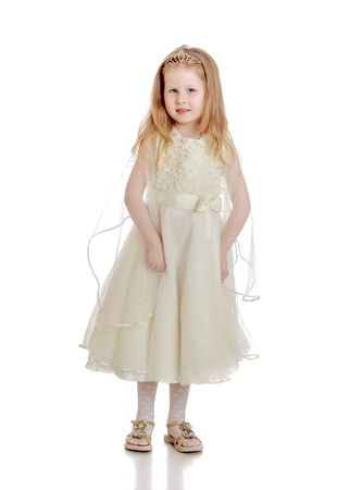chubby girl: Cute little chubby girl is a Princess, with flowing blond hair, dressed in a long white dress - Isolated on white background