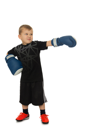 sports uniform: Funny little boy in Boxing gloves in black sports uniform - Isolated on white background Stock Photo