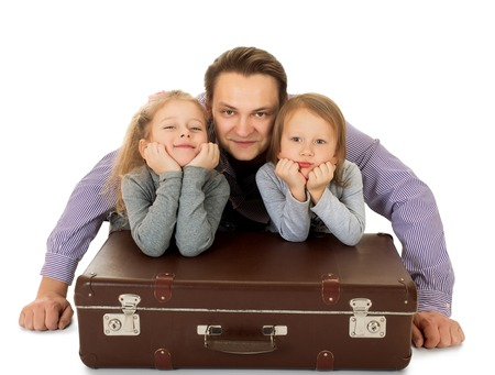 Humorous picture. Fun dad, and two adorable little girls and old Grannys suitcase - Isolated on white background