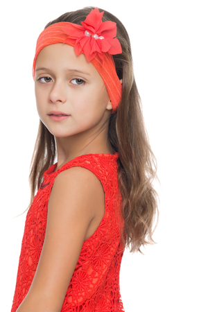 girl in burgundy dress: Beautiful long-haired girl of school age in a smart Burgundy dress and matching headband on her head. Closeup - Isolated on white background