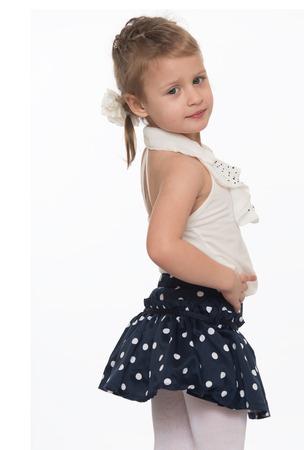 Cute little girl in a short summer skirt with polka dots.