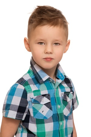 beautiful little boys: Serious little boy with a fashionable hairstyle. Closeup - Isolated on white background Stock Photo