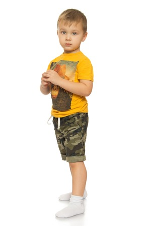boy shorts: Thoughtful little blond boy - Isolated on white background Stock Photo