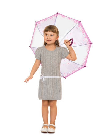 umbrela: Beautiful girl with long blonde hair and short bangs standing under an umbrella - Isolated on white background