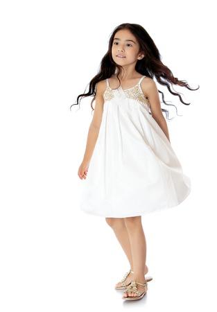 schoolgirl uniform: Stylish dark-haired girl in a fashionable white dress - Isolated on white background Stock Photo