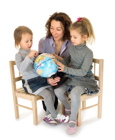 enthusiastically: Mother and two daughters enthusiastically exploring the globe - Isolated on white background