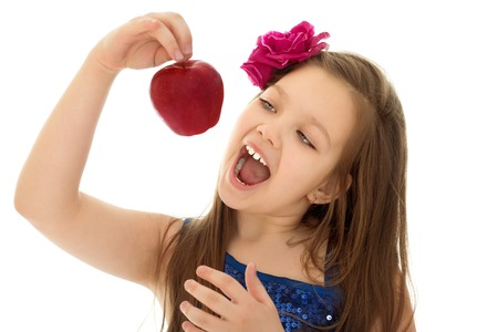 outstretched hand: Beautiful girl holding on outstretched hand a big red Apple, the girl opened her mouth to this Apple to bite . Close-up - Isolated on white background