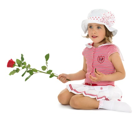 dressy: Beautiful little girl in a dressy summer dress and white Panama keeps in hand a rose - Isolated on white background