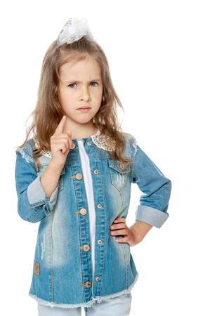threatens: Closeup of a serious little girl threatens with a finger - Isolated on white background Stock Photo
