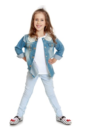 legs apart: Happy little girl in denim suit posing with his legs apart - Isolated on white background Stock Photo