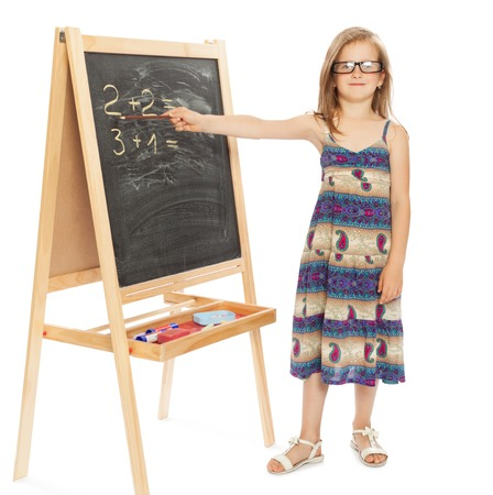 solves: Funny girl in glasses solves problems around the school Board - Isolated on white background