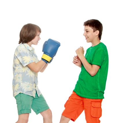 boy boxing: Two teenager boy Boxing each other-Isolated on white background