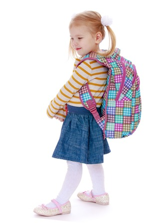 knapsack: Fair-haired little girl with a big knapsack on his back - Isolated on white background