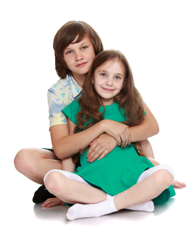 Brother and sister posing for the camera-Isolated on white background