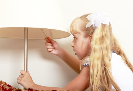 Interested in little girl includes a floor lamp in the room