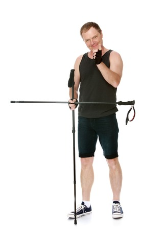 threatens: Man in t-shirt and shorts, Nordic walking sticks, threatens finger -Isolated on white background Stock Photo