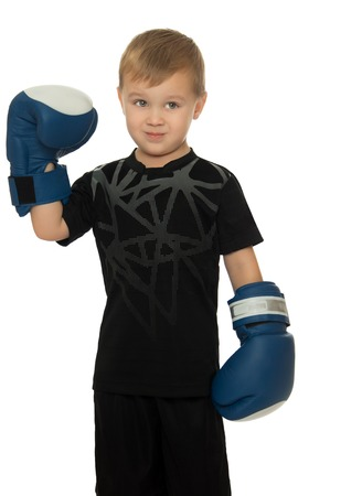 Little boy engaged in Boxing. In his hands he's got the Boxing gloves. Close-up- Isolated on white background