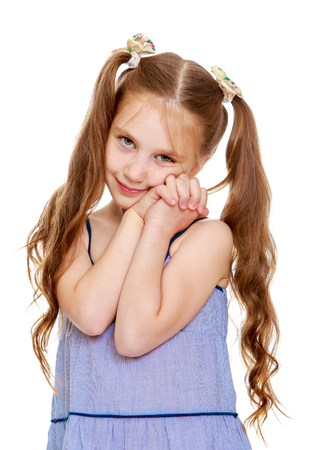 ponytails: Beautiful little girl with long ponytails on the head. Close-up-Isolated on white background