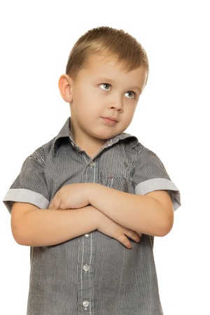 put away: Cute little boy put his hands on his chest and looks away. Close-up - Isolated on white background Stock Photo