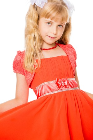 Beautiful little girl with long, blonde ponytails on her head in a bright orange dress . close-up-Isolated on white background