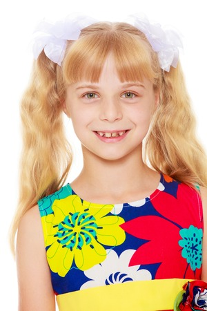 Sweet, adorable little girl with long blonde ponytails on her head tied with white bows. Close-up-Isolated on white background Stock Photo