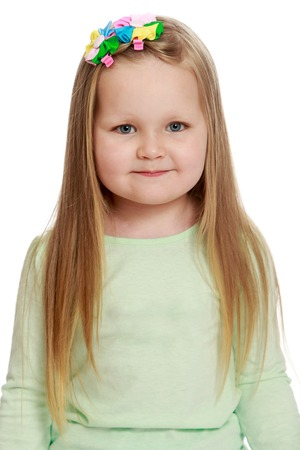 Close-up .Adorable little round-faced girl with long, blonde hair below the shoulders, little Princess - Isolated on white background Stock Photo