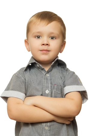 looking directly at camera: Cute little boy put his hands on his chest and looking directly at the camera. Close-up - Isolated on white background Stock Photo