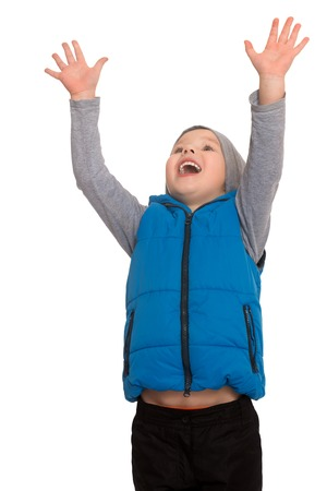 flashy: Flashy little boy happily raised his hands up. Close-up - Isolated on white background