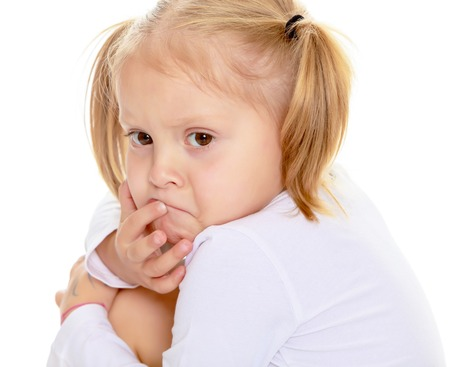 shool: Distressed small, blonde girl with white t-shirts without a pattern.Isolated on white background Stock Photo