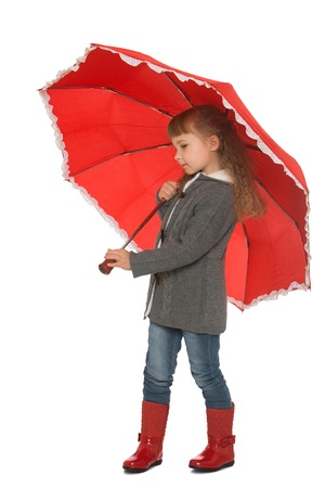 umbrela: Beautiful little girl in autumn clothes under the red umbrella - Isolated on white background Stock Photo