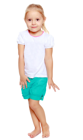 shool: Cute little blond girl in white tank top without a pattern.Cute girl poses for the camera.Isolated on white background