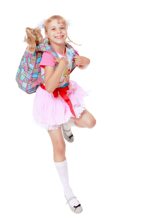 falda corta: Cheerful little girl in a pink short skirt hurries to school-Isolated on white background