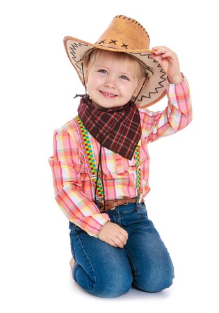 Cute little girl in jeans,a plaid shirt does not a cowboy hat . close-up-Isolated on white background