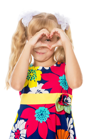 ponytails: Beautiful little girl with long blond hair braided in ponytails , folded palms heart-Isolated on white background