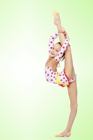 Gymnast doet de splitsingen Stockfoto