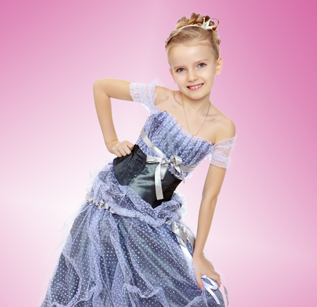 Beautiful little girl in Princess dress. Stock Photo